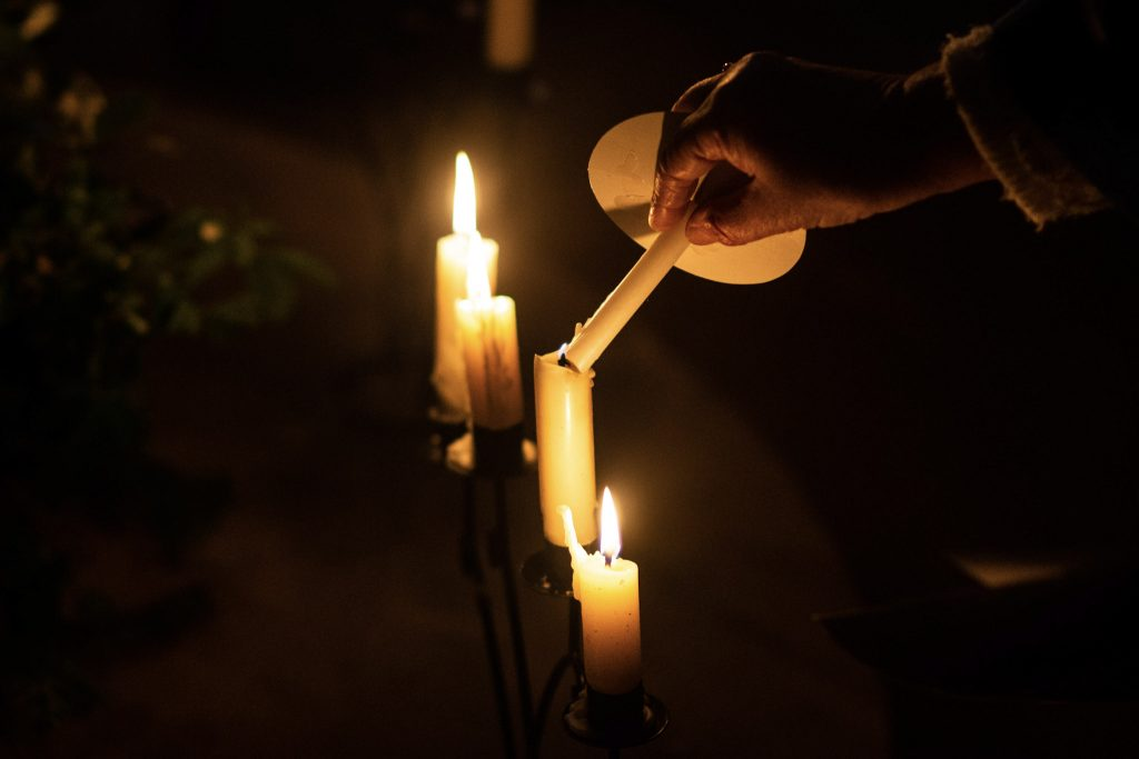 Image of person lighting candles